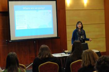 Kathy kuhl speaking at a workshop