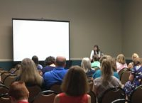 Kathy Kuhl speaking to parents at a convention