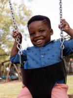 Small boy on swing