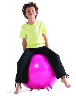 child sitting on exercise ball